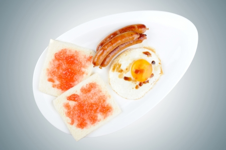 fired egg: breakfast set, fired egg, sausages and sliced of bread with strawberry jam (with Clipping Path)