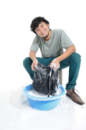Thai man washing by hands in plastic bowl photo