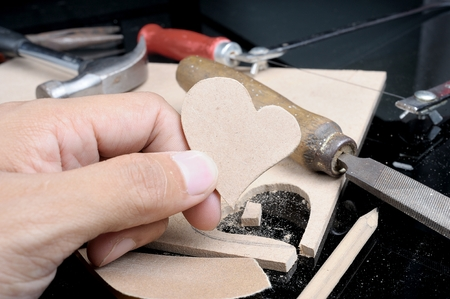 the man made heart shape from plank