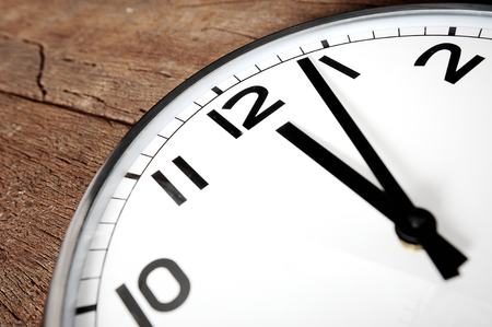 show time: classic clock show time passing noon. Stock Photo