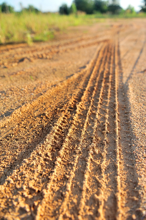 detail of tyre tracks in sand photo