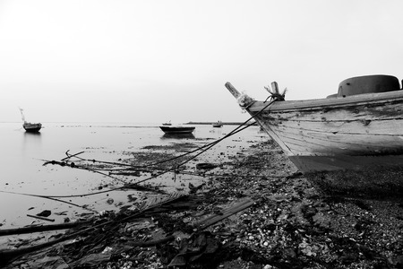 garbage on the beach in black and white photo