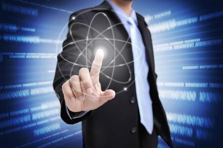 closeup the finger of businessman touching an imaginary screen photo