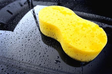yellow sponge on the black car photo