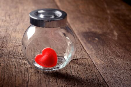 red heart shaped candies in preserving glass photo