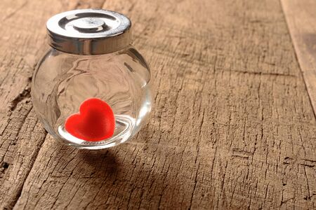 beloved: red heart shaped candies in preserving glass Stock Photo