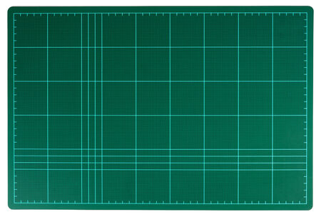 green cutting mat isolate on white background photo