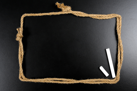 blank blackboard with rope frame photo