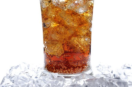A glass of cola with ice cubes photo