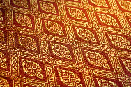 closeup golden pattern of Thai fabric  photo