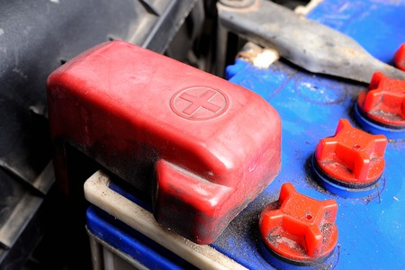 old red battery car terminal cap photo