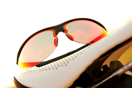 protecting spectacles: isolated red sunglasses for cycling