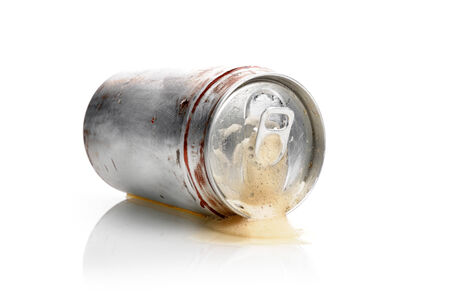 expire: unhealthy soft drink splash out of the can Stock Photo