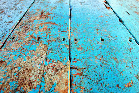 chafe: abstract old and grungy wooden with blue painted on the surface