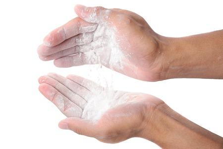 detail of powder in hand on white background, Body powder, ingredient of food