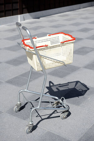 alone shopping cart in the parking photo