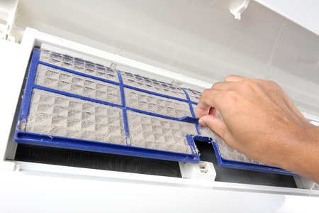 very dirty: cleaning very dirty air conditioner filter Stock Photo