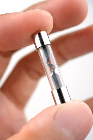 ampere: closeup fuse in human hand