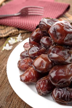 dates fruit: closeup sweet dried dates fruit Stock Photo