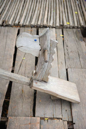 vintage seesaw board with cute horse head in Thailand photo