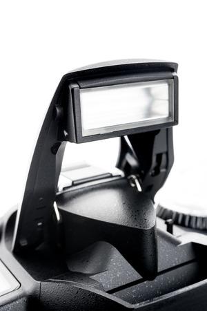 closeup details of professional digital camera built-in flash