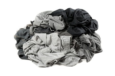 Big heap of dirty dark color clothes isolated on white background