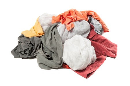 Big heap of dirty colorful clothes isolated on white background Reklamní fotografie