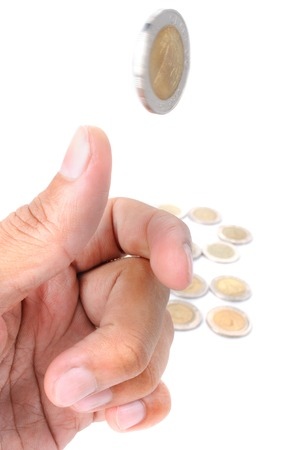 coin toss: man ready to flip Thai 10 Baht coin on white background