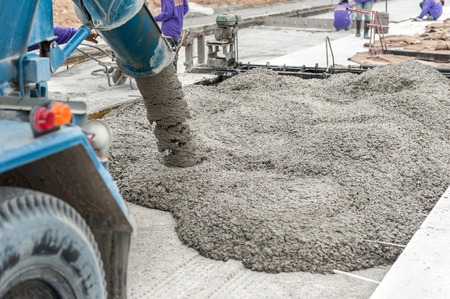 mixed concrete pouring at construction site