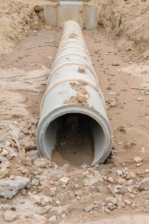 Concrete drainage pipe under construction