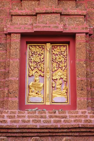 lord buddha: ancient golden carved shown biography of lord buddha on wooden window of Thai temple
