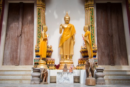 revere: golden Buddha image in Thai temple