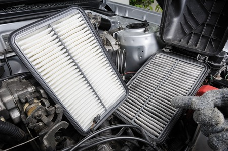 dirty car: comparison between new and used air filter for car, automotive spare part