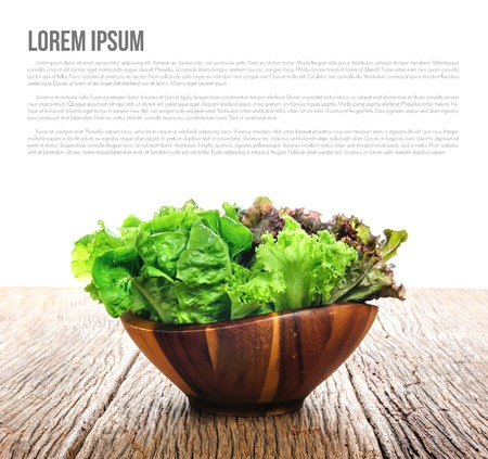 lettuces: closeup isolate fresh lettuces in wooden bowl on wooden desk Stock Photo