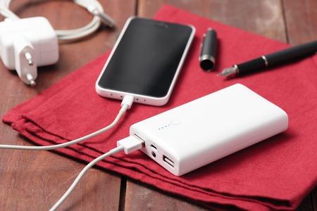 white power bank charging smart phone