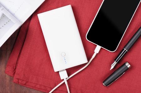 white power bank charging smart phone
