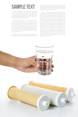 water filter: a glass of water in hand with water filter