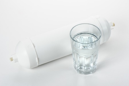 filtration: white cartridge for water filtration on white background