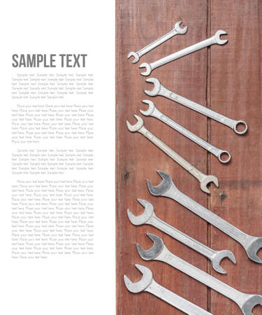 wrenches: wrenches on wooden plank background