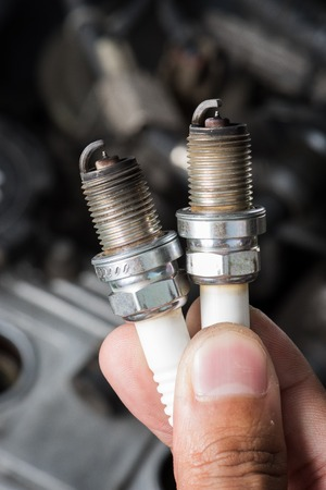soot: used spark plugs with soot Stock Photo