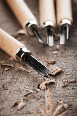 gouge: closeup chisels for wood on carpenter desktop