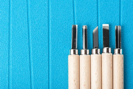 gouge: Set of new chisels isolated on blue background