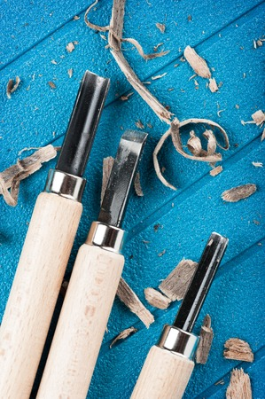 chisels: closeup chisels for wood on blue background