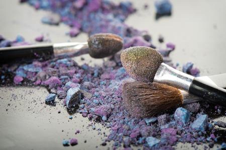 expire: closeup expire colorful cosmetics with brush
