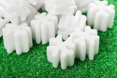 pellets: fill packing foam pellets on green background Stock Photo