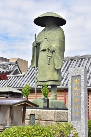 administered: OSAKA, JAPAN - NOVEMBER 06, 2014: Japanese monk statue at Shitennoji temple. It is the first Buddhist and oldest officially administered temple in Japan. Editorial