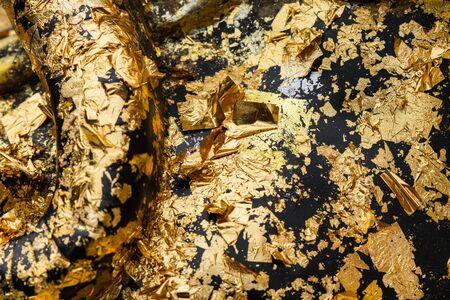 gold leaf: abstract gold leaf on black statue