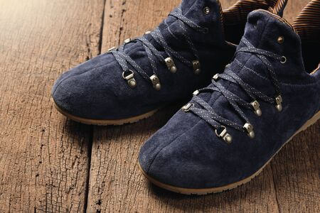 suede: blue suede shoes on wooden plank