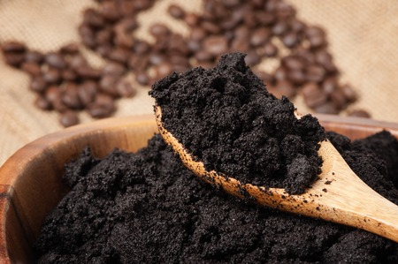 closeup detail of coffee ground in wooden bowl Stock Photo