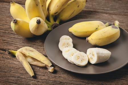 peeled cultivated banana on brown plate